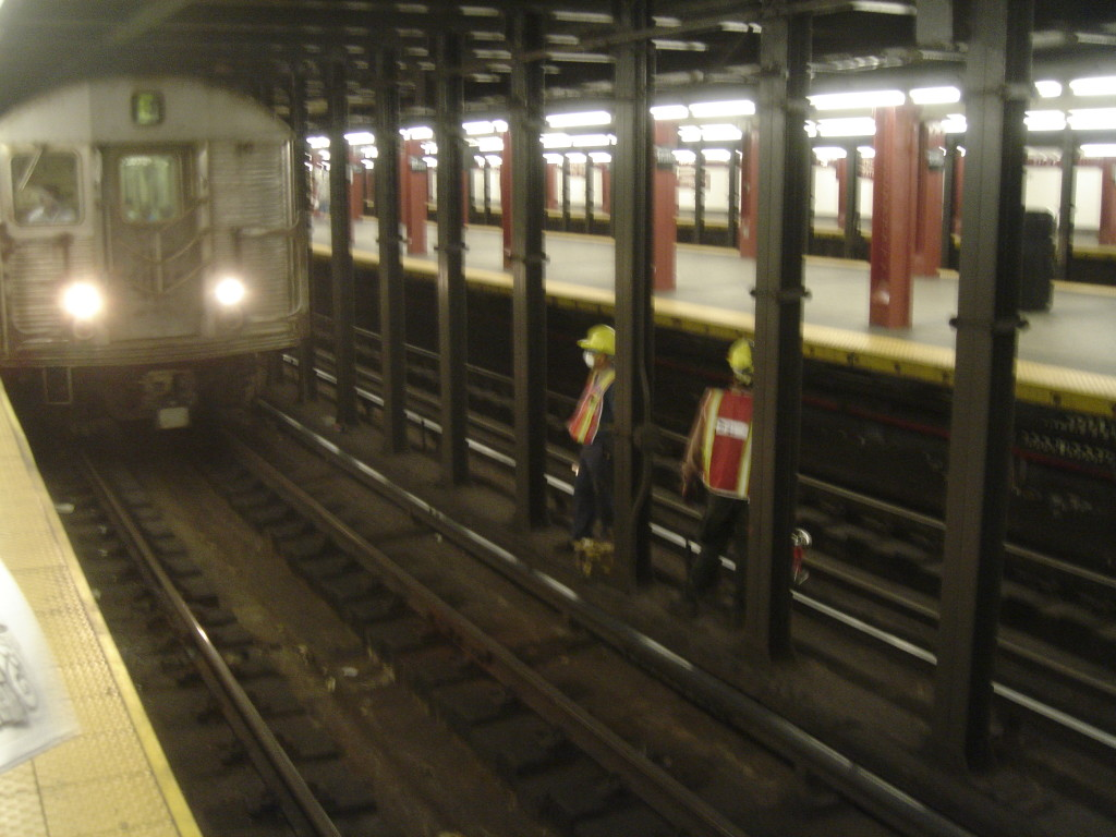 Construction_workers_on_subway_track_at_34_St-Penn_Station